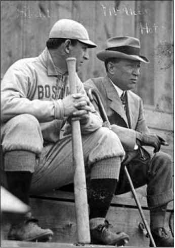 Manager (and part-owner) Jake Stahl confers with owner Jimmy McAleer during a spring training game at Hot Springs.
