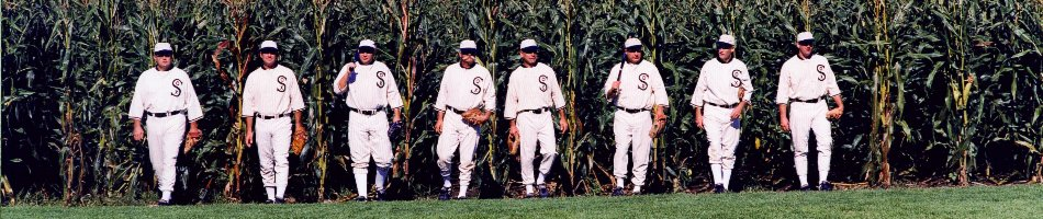 Players walking out of a corn field