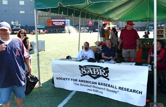 Maury Brown after visiting NWSABR booth manned by Mike Lynch, Leslie & Tim Herlich, and Mary Groebner